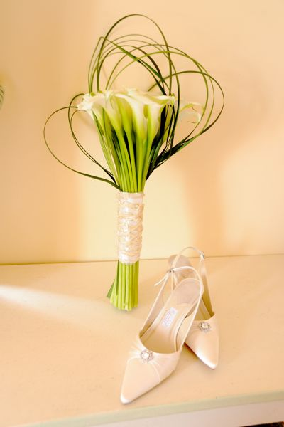 bridal bouquet, white calla lillies and bear grass